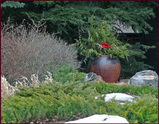 Containers are a valuable addition to the winter landscape - the container itself serves as the focal point and also allows for the use of seasonal arrangements, as this homeowner has created. In this example the rocks play a supporting role rather than focal. Photo: Sue Gaviller