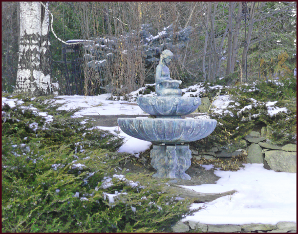 I drove by this garden recently while taking an alternate route home - this charming lady presents an elegant focal point and would be equally lovely even in the absence of snow. Photo: Sue Gaviller