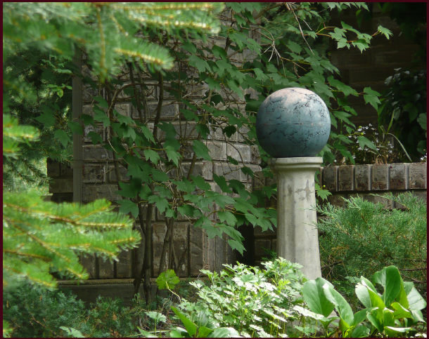 A focal point, in any season, can pull together an otherwise nondescript scene. This gazing ball is surrounded by woody and evergreen plant material surround, so will have the same effect in winter as well. Photo: Sue Gaviller