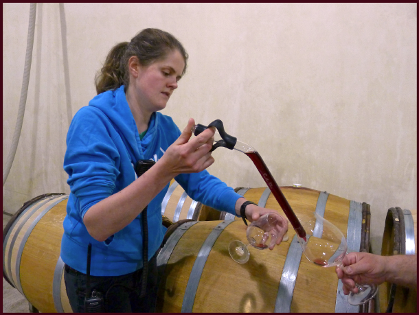 The lovely Gabby offers us a barrel tasting of a 2013 Aliette Pinot Noir. Photo: Sue Gaviller